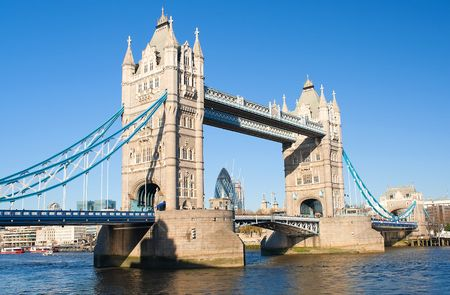 The Tower Bridge in London with the Gherkin building in the background in a clear day photo
