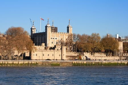 english famous: The Tower of London seen across the river Thames in a clear day