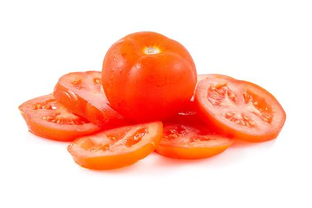 Fresh red tomato and tomato slices on a white background Stock Photo - 6112912