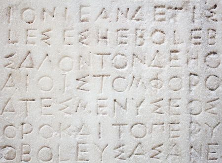 the architecture is ancient: Ancient greek inscription carved in white marble Stock Photo