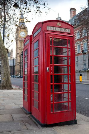 A pair of traditional red phone booths in London with the Big Ben in the background Stock Photo - 6354783