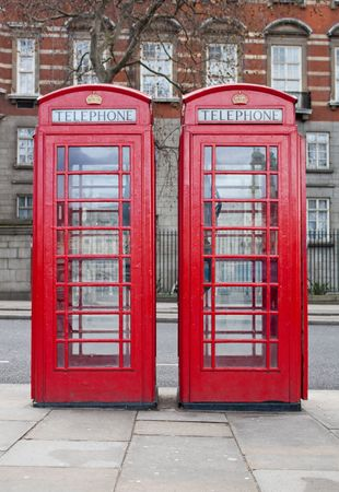 Two traditional red phone booths in London  photo
