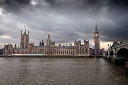 houses parliament: The Big Ben and the Houses of Parliament in London with a dramatic cloudy sky