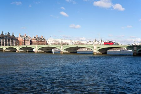 Westminster bridge and a double decker bus in London in a beautiful day Stock Photo - 6421196
