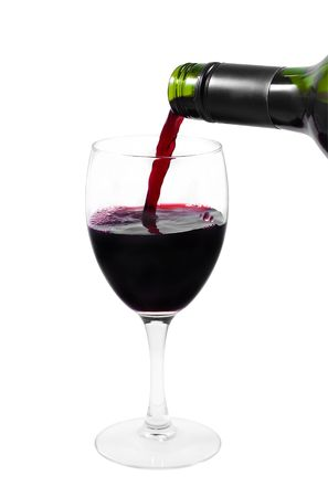 A green bottle pouring red wine into a clear glass isolated on white photo