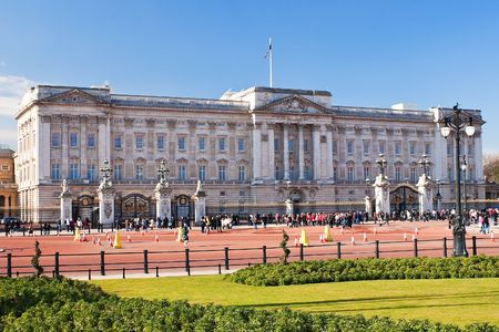 westminster: Buckingham Palace and gardens in London in a beautiful day