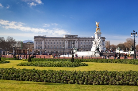 Buckingham Palace and gardens in London in a beautiful day