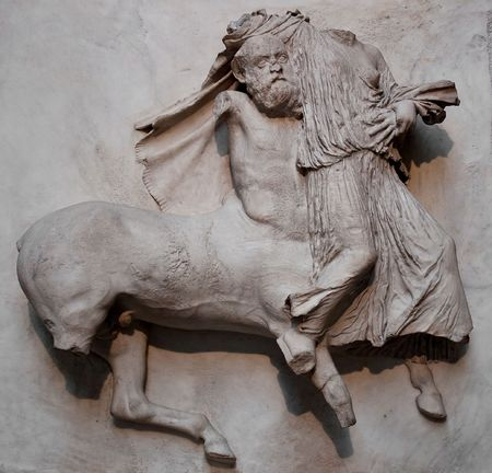 the arts is ancient: Sculpture from the Parthenon representing a centaur kidnapping a woman Stock Photo