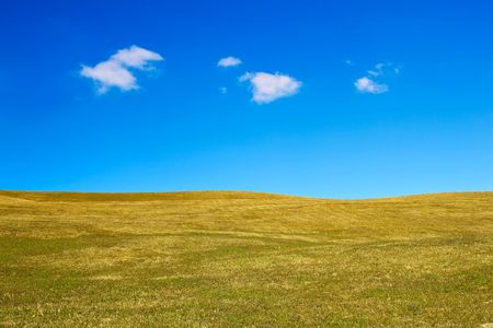 Landscape with grassy hills and a sky with some clouds Stock Photo - 6596068