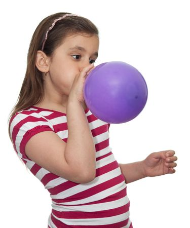 Girl blowing a balloon isolated on white photo