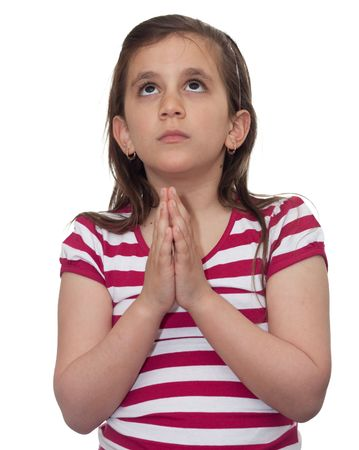 Young girl looking up and praying isolated on white photo