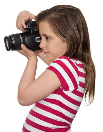 Girl taking a picture with a professional camera isolated on white photo