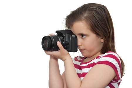 Young girl taking a picture with a professional camera on a white background photo