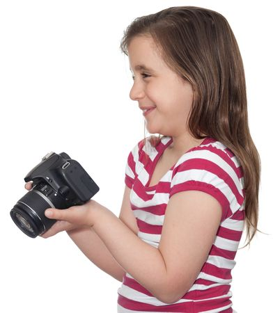 Young girl smiling and holding a camera on a white background photo