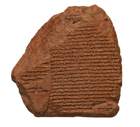Clay tablet with cuneiform writing of the ancient Sumerian  or Assyrian civilization isolated on white Stock Photo - 6918519