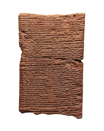 Clay tablet with cuneiform writing of the ancient Sumerian  or Assyrian civilization isolated on white  photo