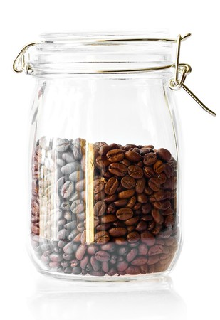 Coffee beans in a cristal jar on a white background photo