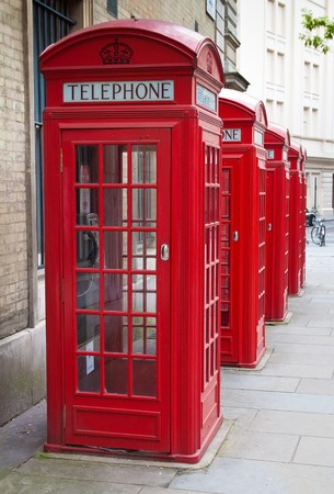 english famous: A group of typical red London phone cabins