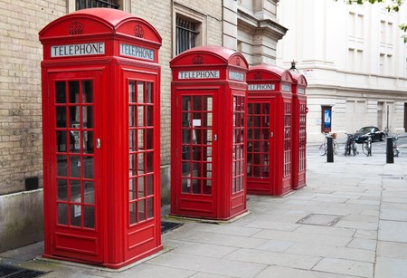 A group of typical red London phone cabins photo