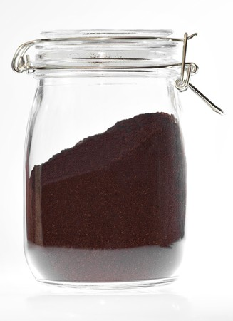A crystal jar of coffee on a white background photo