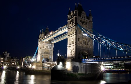 Night view of the Tower Bridge and the river Thames in London photo