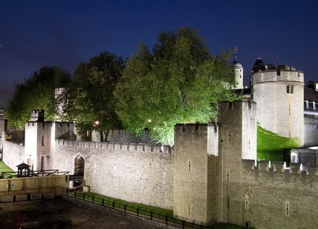 beefeater: The Tower of London illuminated at night Stock Photo