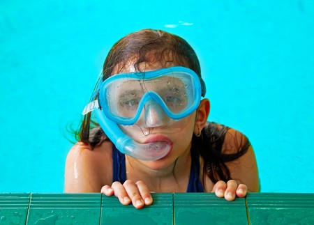 lido: Beautiful girl in a pool with a swimming mask and snorkel