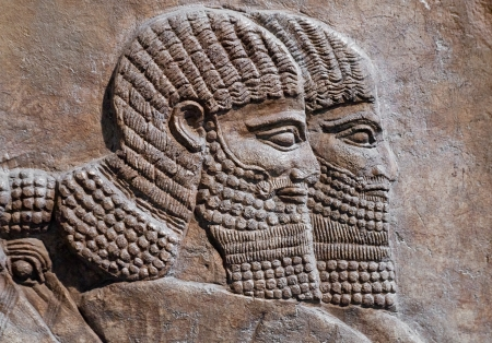 ancient relics: Detail of an ancient relief of two assyrian warriors Stock Photo