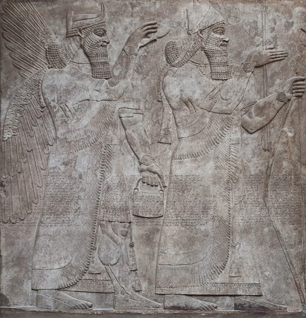 civilisation: Ancient relief of assyrian gods Stock Photo