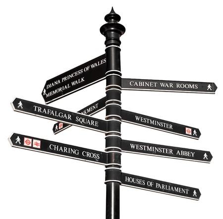 Melden Sie sich mit den Richtungen zu Londons Sehenswürdigkeiten, isoliert auf weiss
