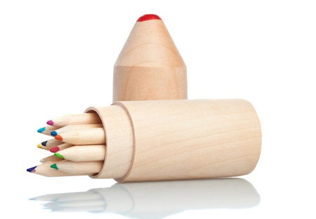Wooden color pencils holder on a white background with reflections Stock Photo - 9383772