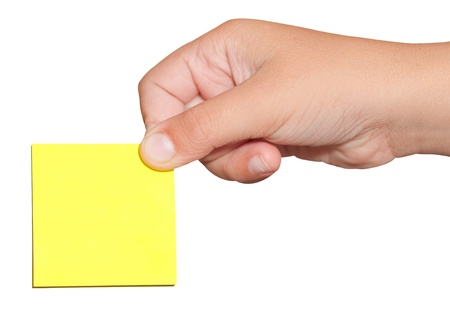 Hand holding a yellow  sticker post-it note isolated on white with clipping path Stock Photo - 9383773