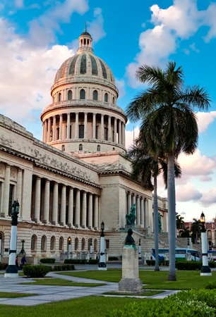 famous place: The Capitol building and gardens in Havana, Cuba at sunset