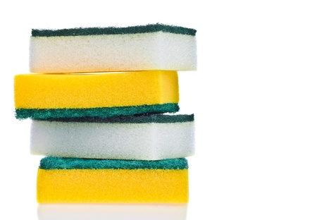 Four scouring pads on a white background
