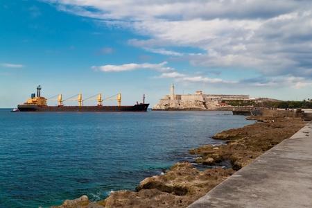 Cargo ship entering the bay of Havana, Cuba photo