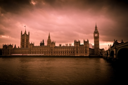 Vintage image of the Big Ben and the Houses of Parliament in sepia tones with a dramatic cloudy sky photo