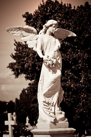 angel tree: Angel in a cemetery in sepia tones