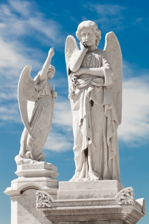 Two white angels with a beautiful sky background photo