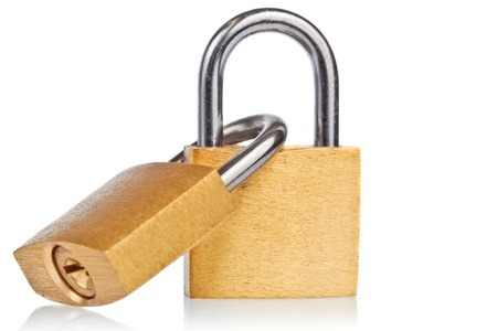 Two linked brass padlocks with reflections on a white background photo
