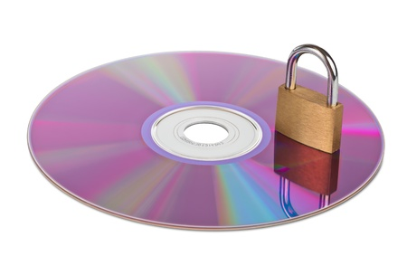 CD or DVD with a closed padlock on top isolated on white with clipping path photo