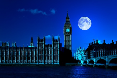 Night scene in London showing the Big Ben, a full moon and Westminster bridge photo