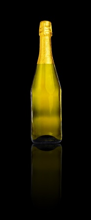gold capped: Bottle of champagne or cava isolated on black with reflection (with clipping path)