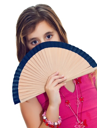 hiding face: Latin girl hiding behind a fan isolated on white Stock Photo