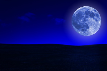 hills land: Grassy hills at night with a bright full moon Stock Photo