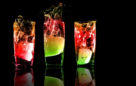 alcoholic beverages: Three exotic tropical cocktails with reflections on a white background