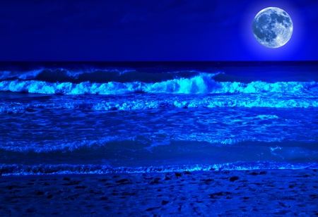 on the black sea: Stormy beach at midnight with a bright full moon Stock Photo