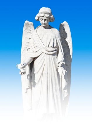 Young female angel statue on a sky background photo