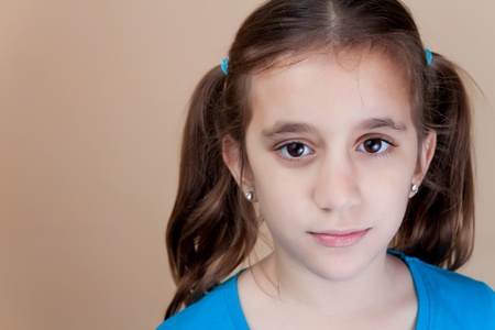 Portrait of a beautiful latin girl with ponytails photo