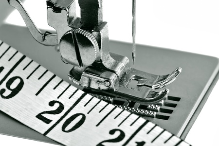 sewing needle: Detail of a sewing machine with a measuring tape Stock Photo