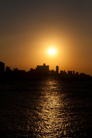 The sun setting over Havana with a silhouetted view of the city skyline Stock Photo - 9397677